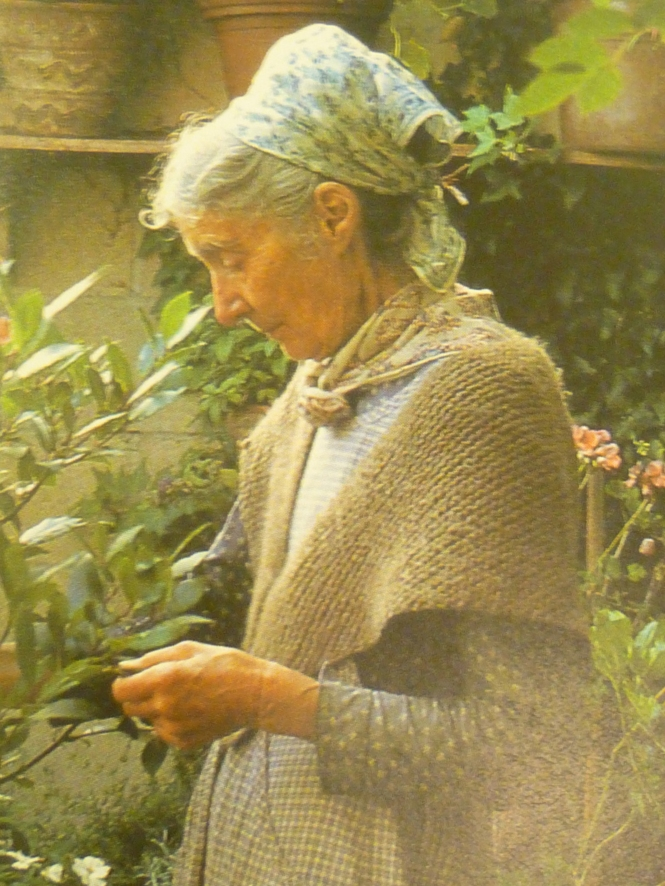 Tasha Tudor wearing her hand- knit shawl in the herb garden!