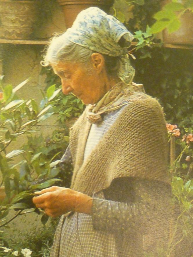 Tasha Tudor wearing her hand- knit shawl in the herb garden!
