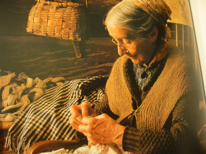Tasha Tudor wearing her hand knit shawl while quilting!